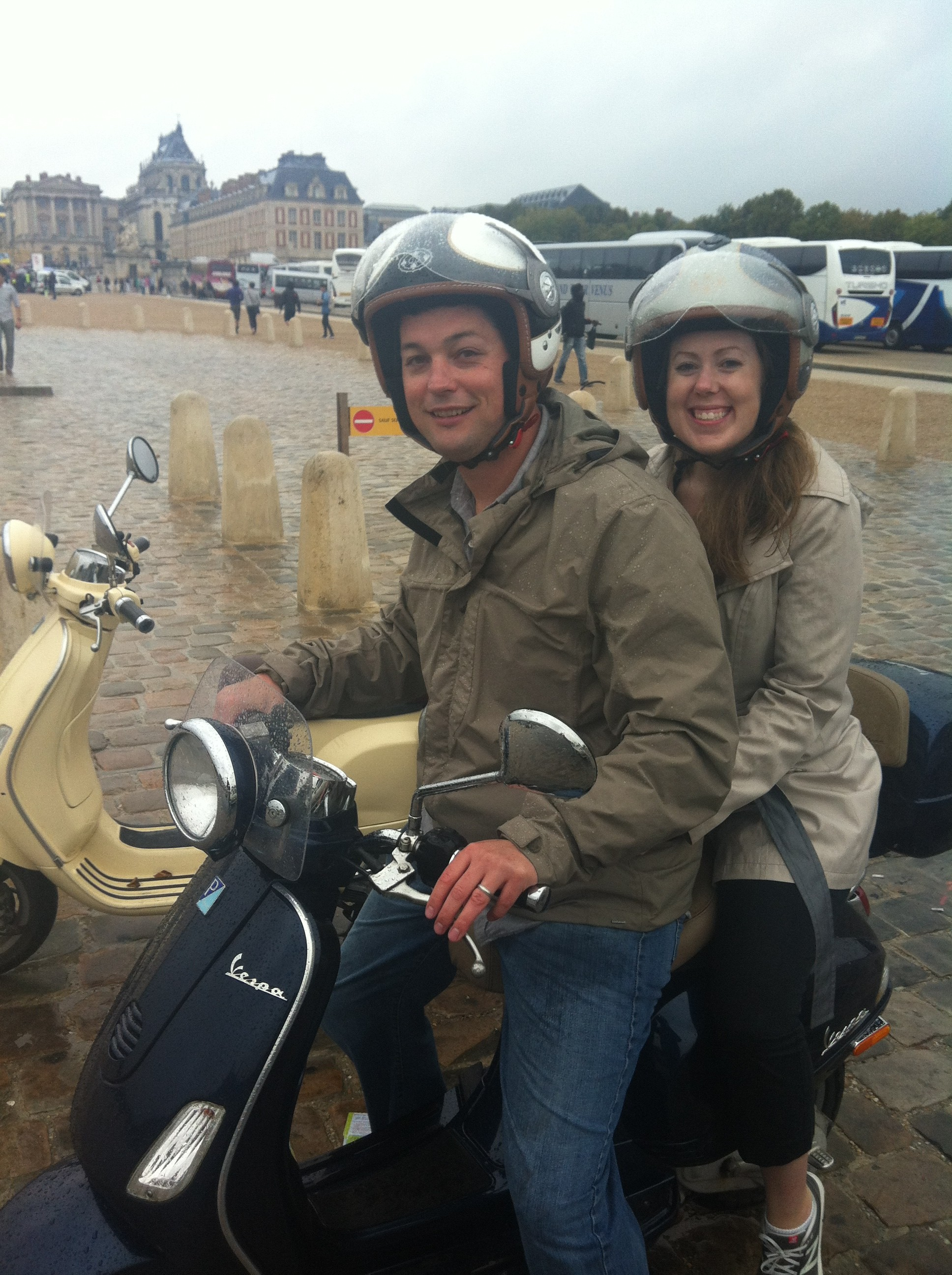Adam and Melissa at Versailles Palace on their scooter after a Paris to Versailles ride.